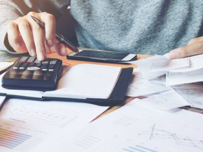 business owner managing business finances using calculator