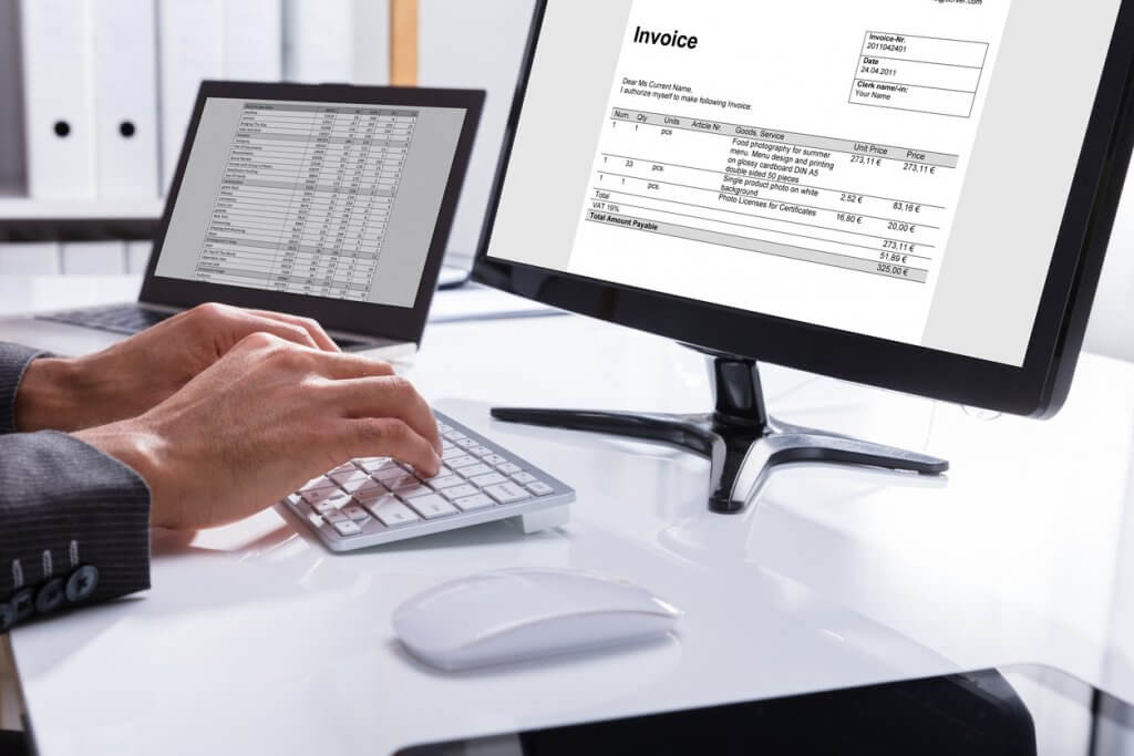 businessman using Concur Invoice to automate invoice management