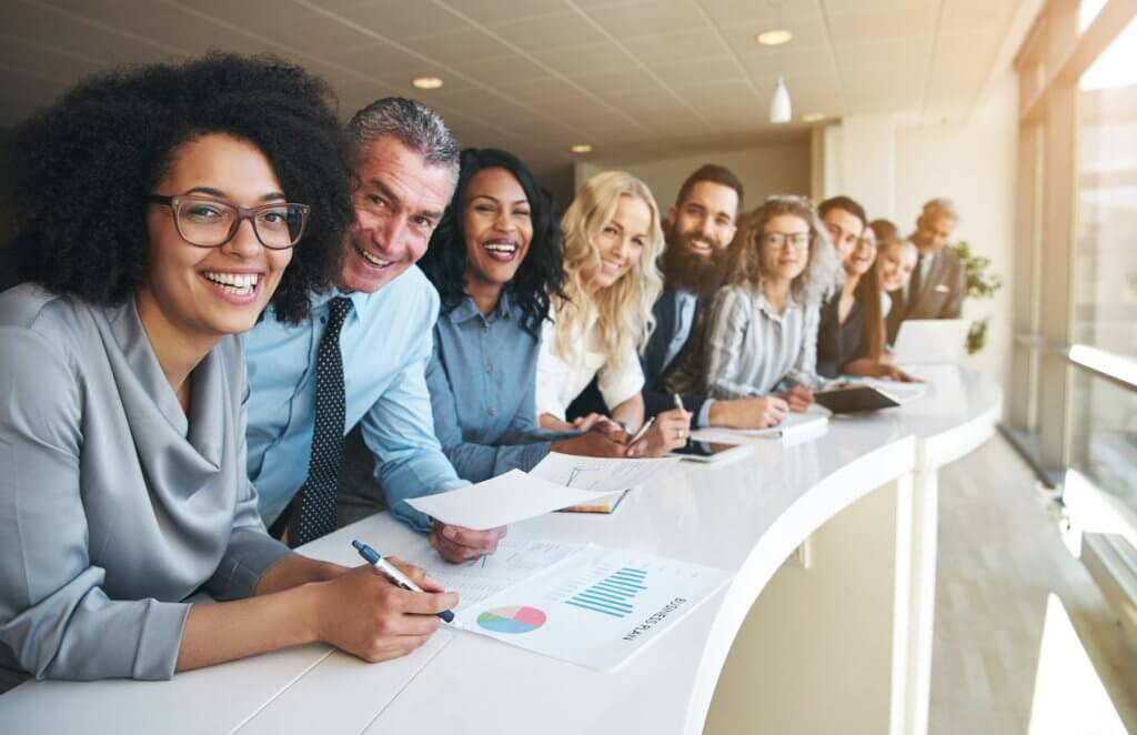 smiling employees of outside accounting firm